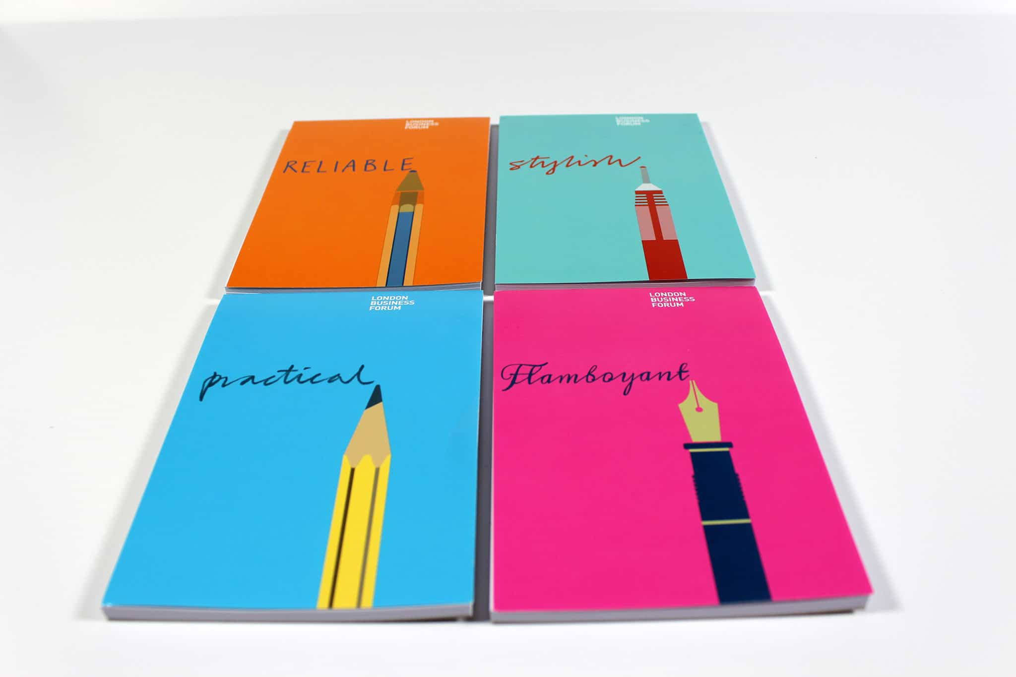 Colourful printed corporate note pads next to each other