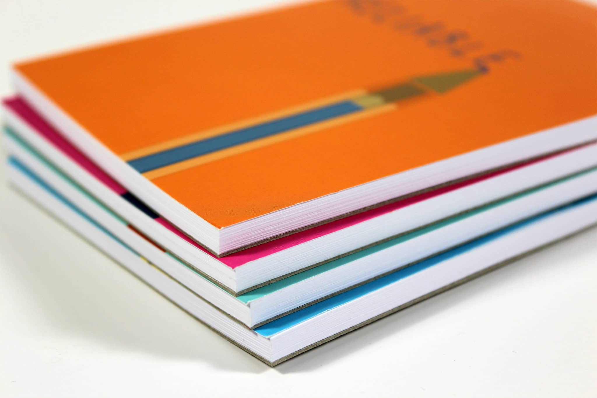 Colourful printed corporate note pads stacked on top of each other