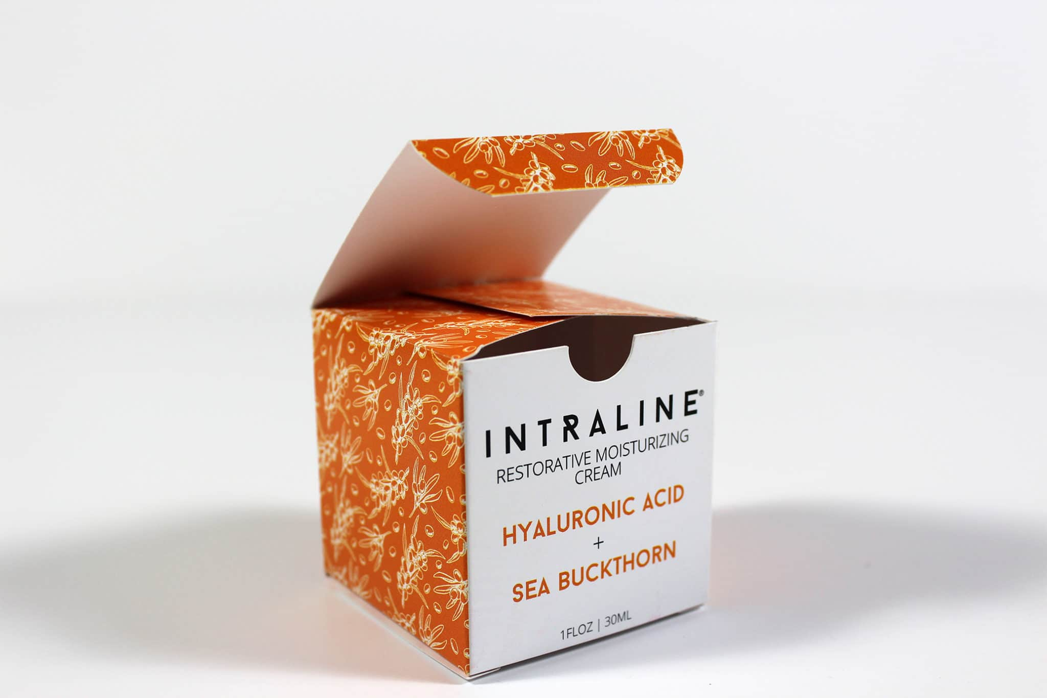 Colourful printed cosmetic packaging box for Intraline with the top open