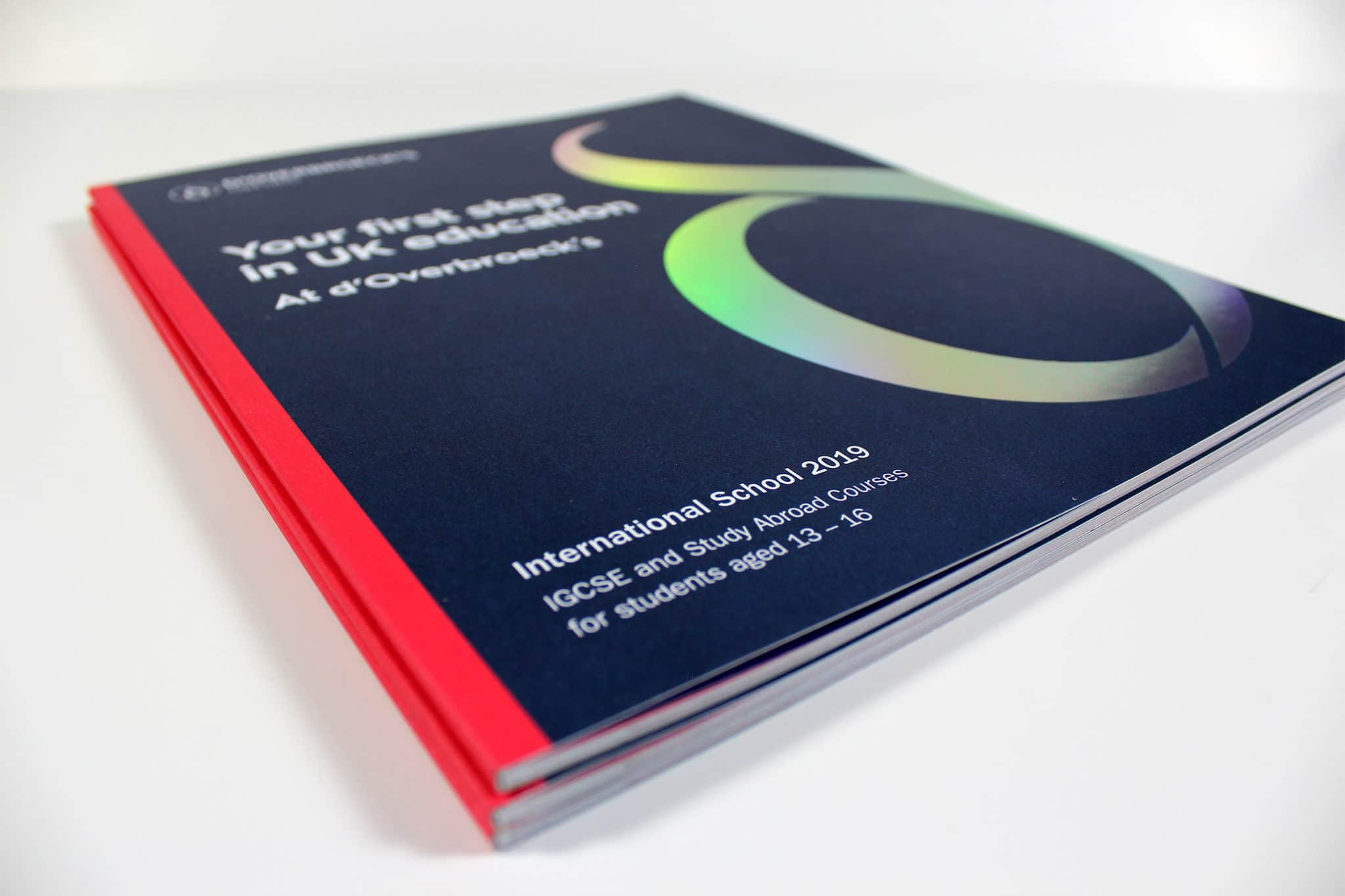 Printed School Prospectus with dark blue cover and rainbow foil