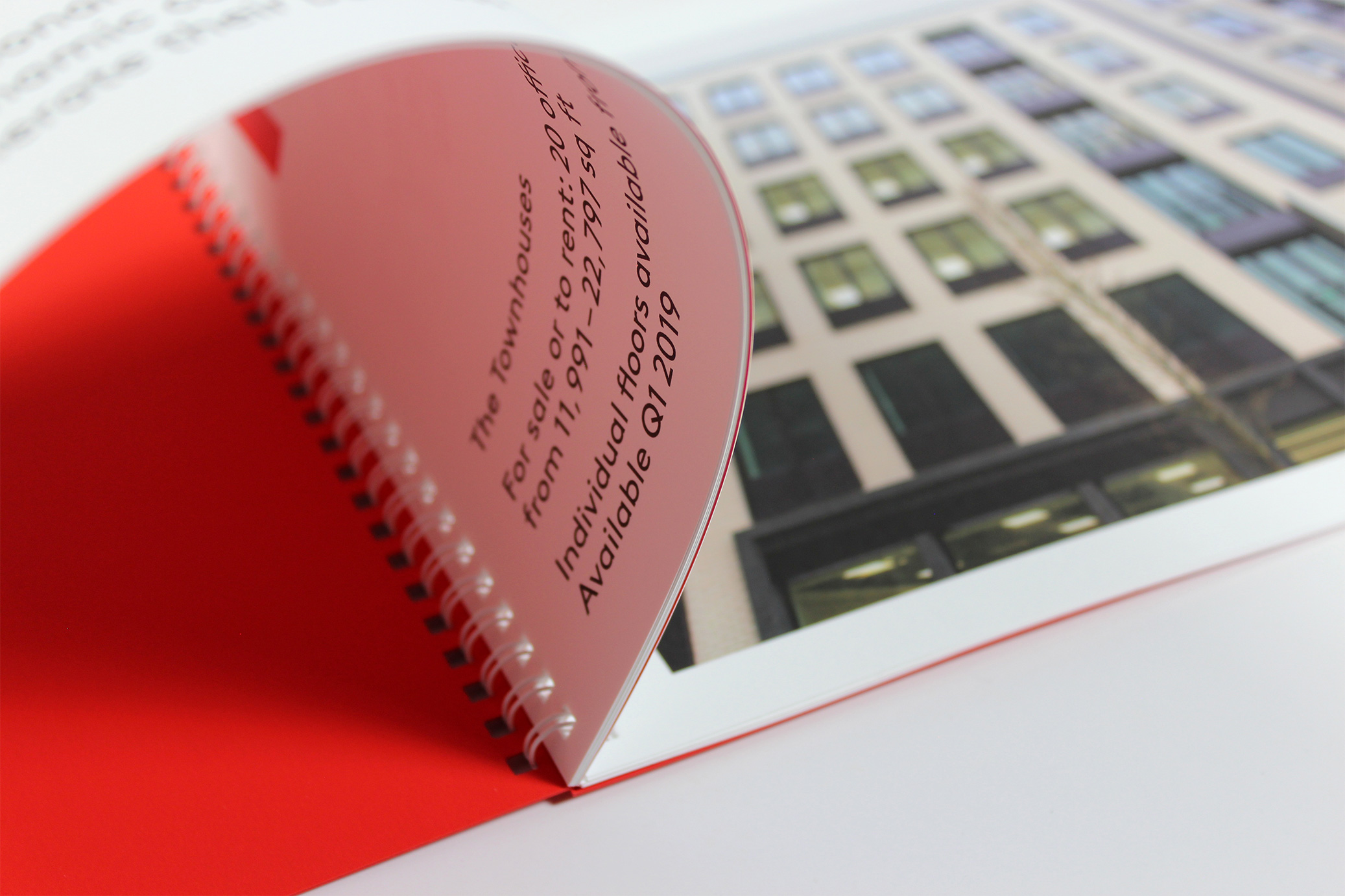 Printed Wiro-bound corporate promotional brochure for RAD - showing the binding, text pages and red card front cover