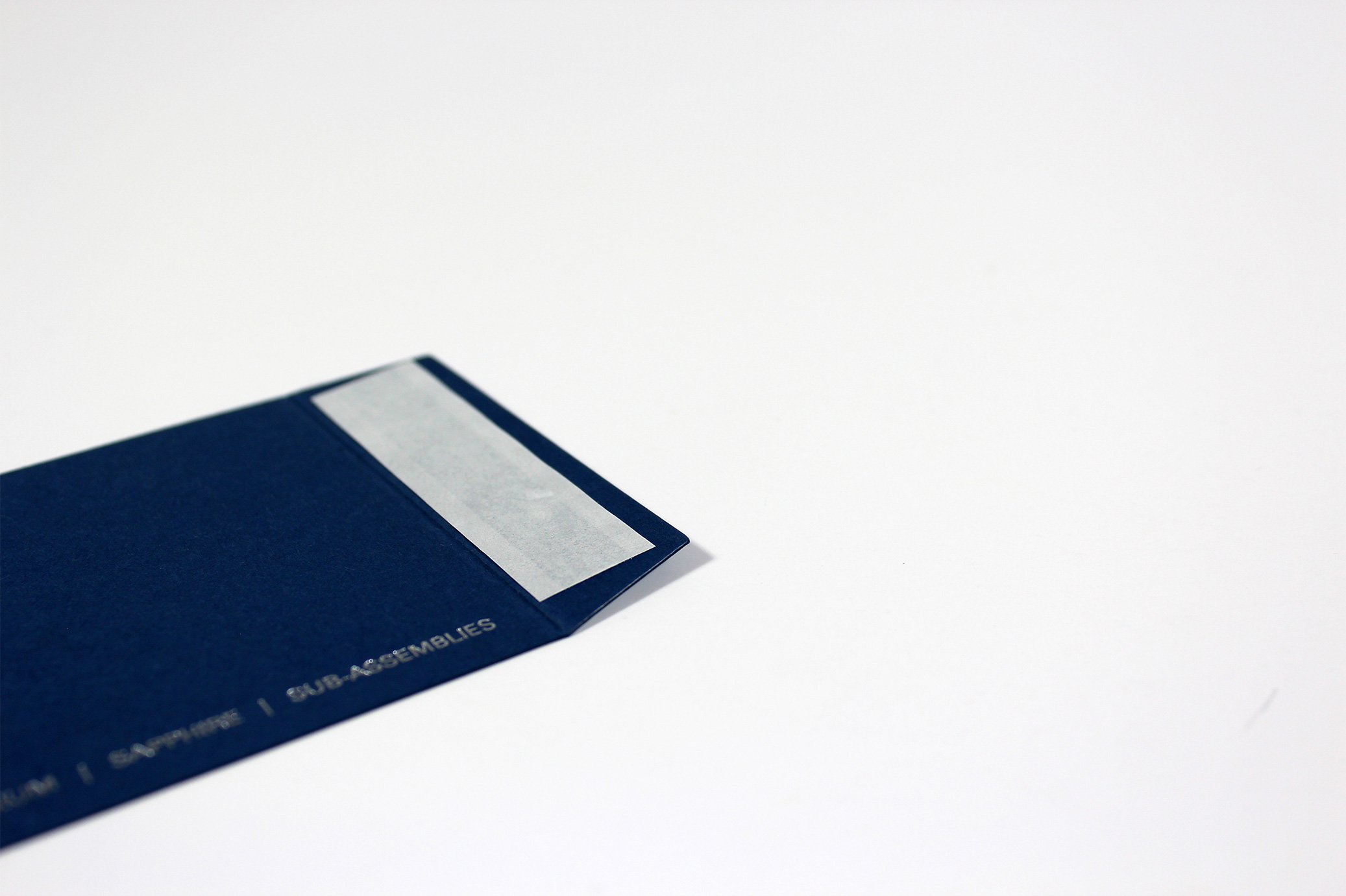 Silver foiled sleeve using blue card and taped on flap for Knight Optical